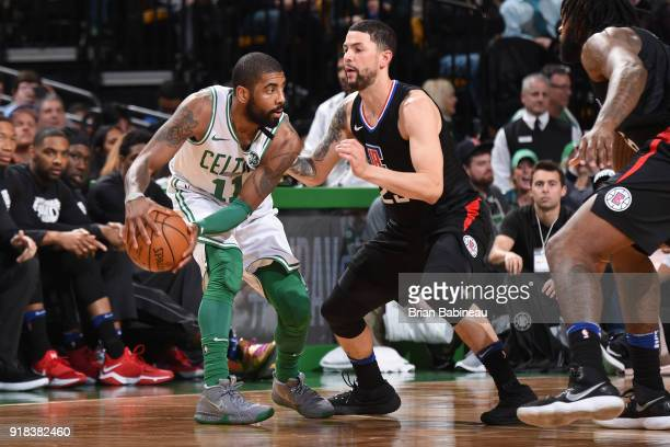 Kyrie Irving of the Boston Celtics looks to pass the ball during the game against the LA Clippers on February 14 2018 at the TD Garden in Boston...