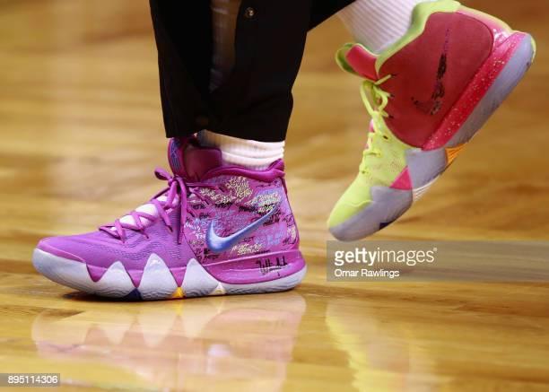 Kyrie Irving of the Boston Celtics new Nike sneakers before the game against the Utah Jazz at TD Garden on December 15 2017 in Boston Massachusetts...