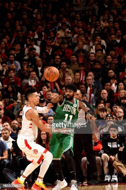 Kyrie Irving of the Boston Celtics passes the ball against the Toronto Raptors on October 19 2018 at Scotiabank Arena in Toronto Ontario Canada NOTE...