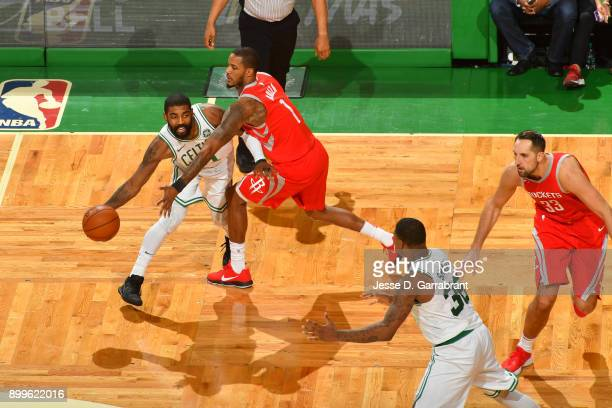 Kyrie Irving of the Boston Celtics passes the ball during the game against the Houston Rockets on December 28 2017 at the TD Garden in Boston...