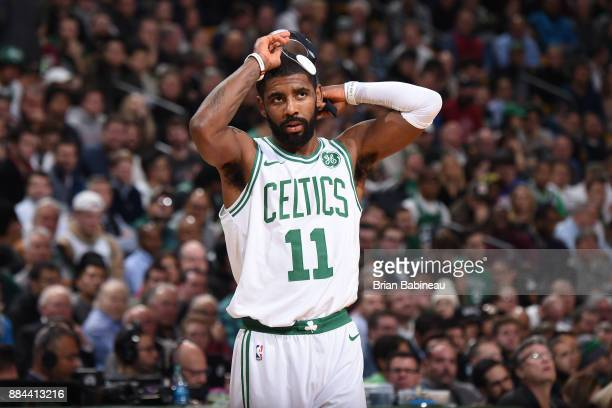 Kyrie Irving of the Boston Celtics puts on his facemask before entering the game against the Philadelphia 76ers on November 30 2017 at the TD Garden...