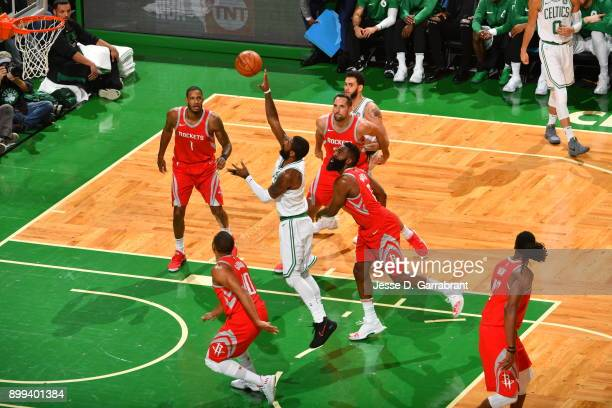 Kyrie Irving of the Boston Celtics puts up the shot during the game against the Houston Rockets on December 28 2017 at the TD Garden in Boston...