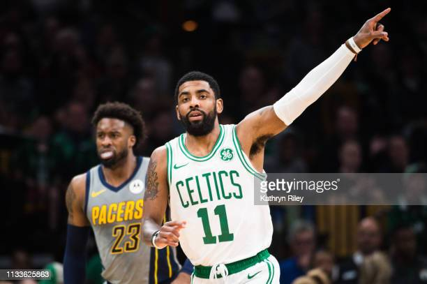 Kyrie Irving of the Boston Celtics reacts after making a threepoint shot against the Indiana Pacers at TD Garden on March 29 2019 in Boston...