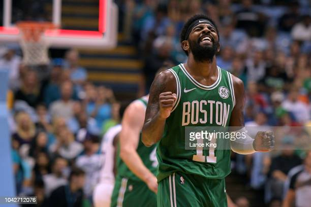 Kyrie Irving of the Boston Celtics reacts after missing a threepoint shot as time expired in the first quarter during their game against the...
