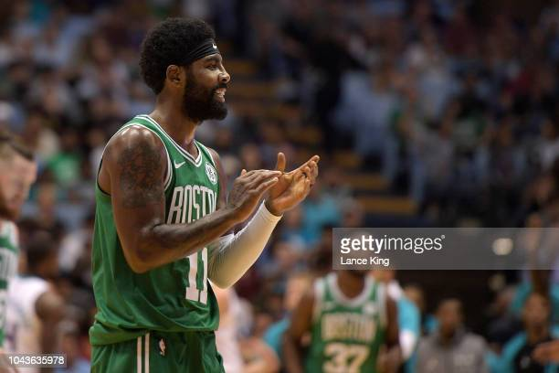 Kyrie Irving of the Boston Celtics reacts after missing a threepoint shot as time expired in the first quarter of their preseason game against the...