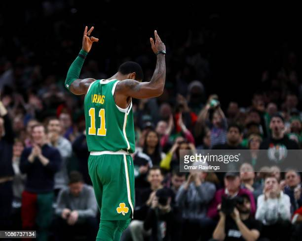 Kyrie Irving of the Boston Celtics reacts during overtime of the game against the Philadelphia 76ers at TD Garden on December 25 2018 in Boston...