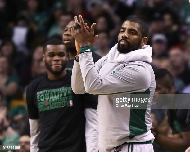 Kyrie Irving of the Boston Celtics reacts on the bench during the second half of the game against the LA Clippers at TD Garden on February 14 2018 in...