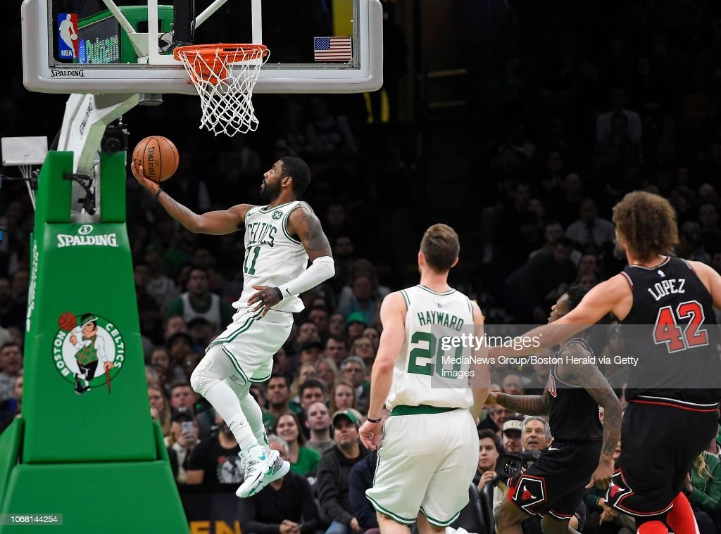 Kyrie Irving of the Boston Celtics scores against the
