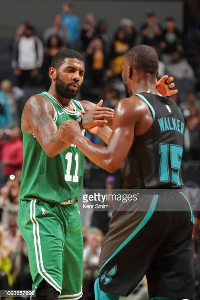 Kyrie Irving of the Boston Celtics shake hands with Kemba Walker of the Charlotte Hornets on November 19 2018 at Spectrum Center in Charlotte North...