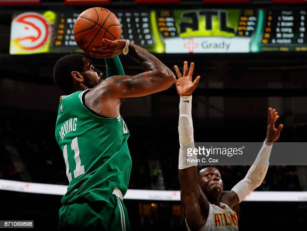 Kyrie Irving of the Boston Celtics shoots a basket against Dennis Schroder of the Atlanta Hawks at Philips Arena on November 6 2017 in Atlanta...