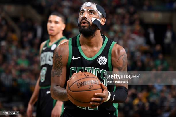 Kyrie Irving of the Boston Celtics shoots a free throw during the game against the Orlando Magic on November 24 2017 at the TD Garden in Boston...