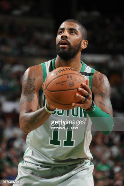 Kyrie Irving of the Boston Celtics shoots a free throw during the game against the Cleveland Cavaliers on February 11 2018 at TD Garden in Boston...