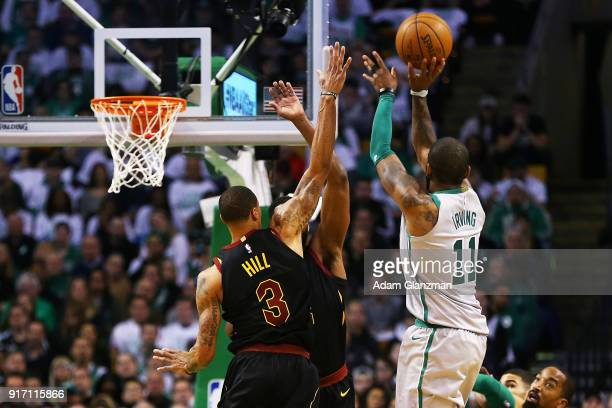 Kyrie Irving of the Boston Celtics shoots during a game against the Cleveland Cavaliers at TD Garden on February 11 2018 in Boston Massachusetts NOTE...