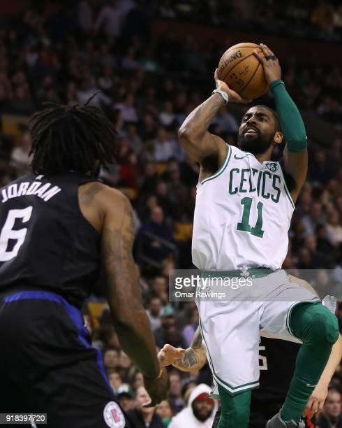 Kyrie Irving of the Boston Celtics shoots over DeAndre Jordan of the LA Clippers during the fourth quarter of the game at TD Garden on February 14...