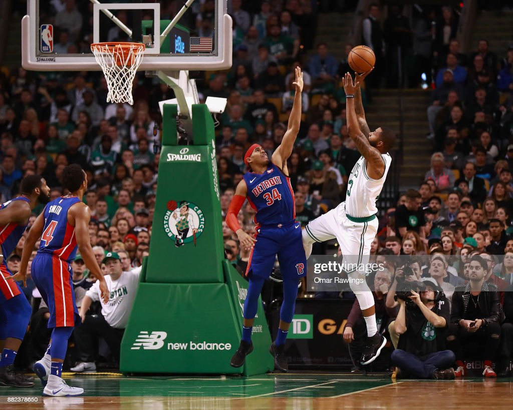 Kyrie Irving #11 of the Boston Celtics shoots over Tobias Harris #34 of the Detroit Pistons during the game at TD Garden on November 27, 2017 in Boston, Massachusetts.
