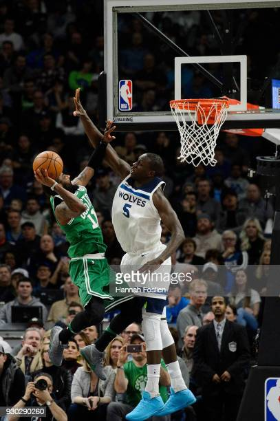 Kyrie Irving of the Boston Celtics shoots the ball against Gorgui Dieng of the Minnesota Timberwolves during the game on March 8 2018 at the Target...