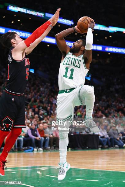 Kyrie Irving of the Boston Celtics shoots the ball against Ryan Arcidiacono of the Chicago Bulls during the first half at TD Garden on November 14...