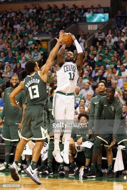 Kyrie Irving of the Boston Celtics shoots the ball against the Milwaukee Bucks on October 18 2017 at the TD Garden in Boston Massachusetts NOTE TO...