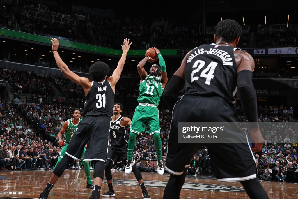Kyrie Irving #11 of the Boston Celtics shoots the ball against the Brooklyn Nets on November 14, 2017 at Barclays Center in Brooklyn, New York.