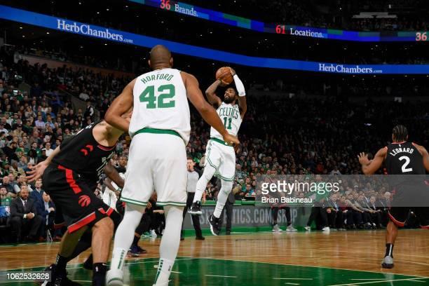 Kyrie Irving of the Boston Celtics shoots the ball against the Toronto Raptors on November 16 2018 at the TD Garden in Boston Massachusetts NOTE TO...
