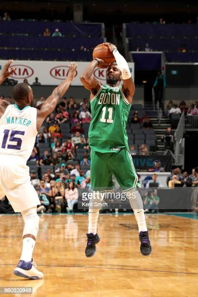Kyrie Irving of the Boston Celtics shoots the ball against the Charlotte Hornets on October 11 2017 at Spectrum Center in Charlotte North Carolina...