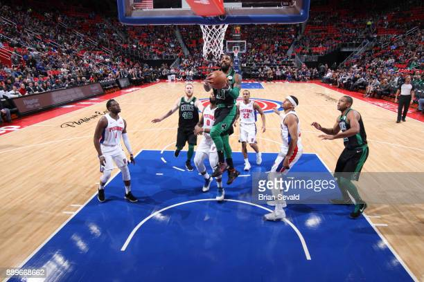 Kyrie Irving of the Boston Celtics shoots the ball against the Detroit Pistons on December 10 2017 at Little Caesars Arena in Detroit Michigan NOTE...