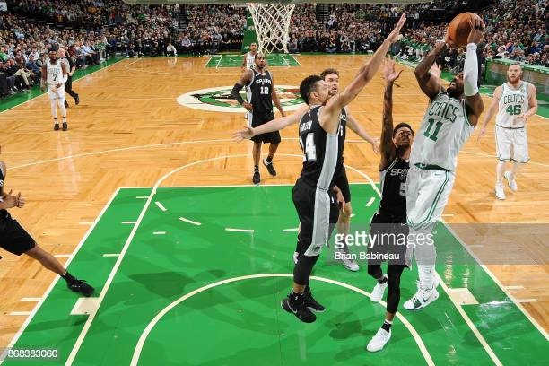 Kyrie Irving of the Boston Celtics shoots the ball against the San Antonio Spurs on October 30 2017 at the TD Garden in Boston Massachusetts NOTE TO...