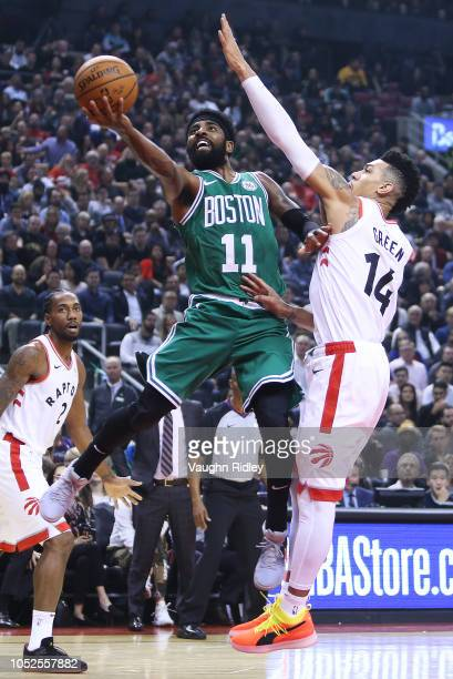 Kyrie Irving of the Boston Celtics shoots the ball as Danny Green of the Toronto Raptors defends during the first half of an NBA game at Scotiabank...