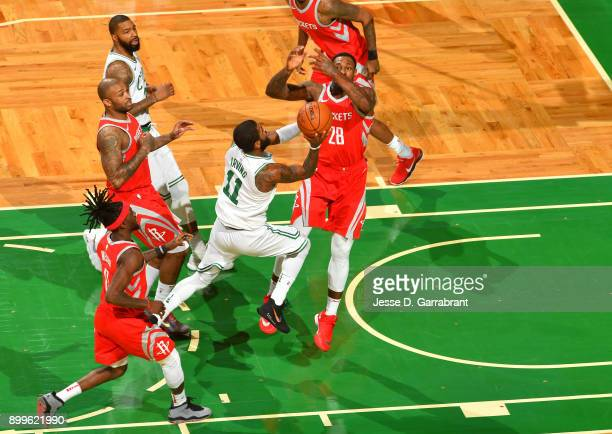 Kyrie Irving of the Boston Celtics shoots the ball during the game against the Houston Rockets on December 28 2017 at the TD Garden in Boston...