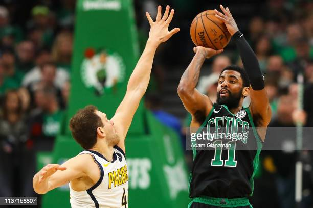 Kyrie Irving of the Boston Celtics shoots the ball over Bojan Bogdanovic of the Indiana Pacers during Game One of the first round of the 2019 NBA...