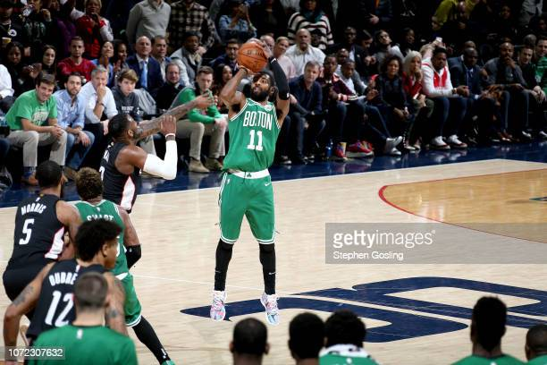 Kyrie Irving of the Boston Celtics shoots the ball to take the lead in overtime against the Washington Wizards on December 12 2018 at Capital One...