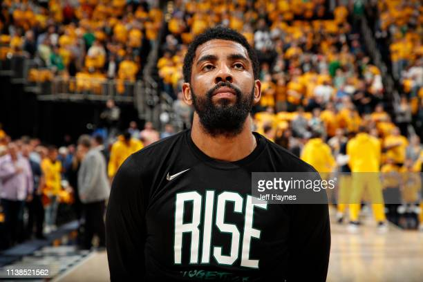 Kyrie Irving of the Boston Celtics stands for the National Anthem before Game Four of Round One of the 2019 NBA Playoffs against the Indiana Pacers...