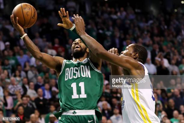 Kyrie Irving of the Boston Celtics takes a shot against Kevin Durant of the Golden State Warriors during the fourth quarter at TD Garden on November...