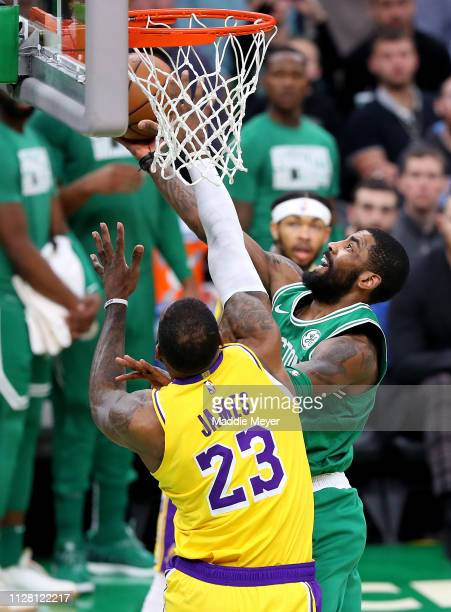Kyrie Irving of the Boston Celtics takes a shot against LeBron James of the Los Angeles Lakers at TD Garden on February 07 2019 in Boston...