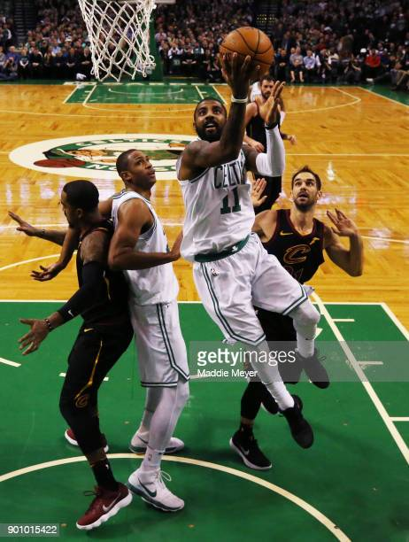 Kyrie Irving of the Boston Celtics takes a shot against the Cleveland Cavaliers during the first half at TD Garden on January 3 2018 in Boston...
