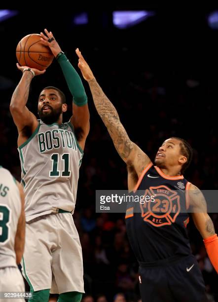 Kyrie Irving of the Boston Celtics takes a shot as Trey Burke of the New York Knicks defends at Madison Square Garden on February 242018 in New York...