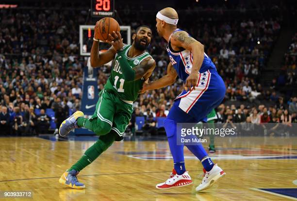 Kyrie Irving of the Boston Celtics takes on Jerryd Bayless of the Philadelphia 76ers during the NBA game between Boston Celtics and Philadelphia...