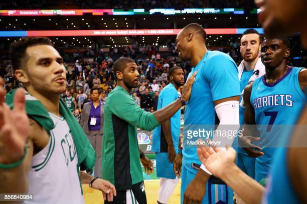 Kyrie Irving of the Boston Celtics talks with Dwight Howard of the Charlotte Hornets after the Celtics defeat the Hornets 9482 at TD Garden on...