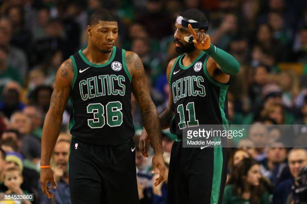 Kyrie Irving of the Boston Celtics talks with Marcus Smart during the first half against the Phoenix Suns at TD Garden on December 2 2017 in Boston...