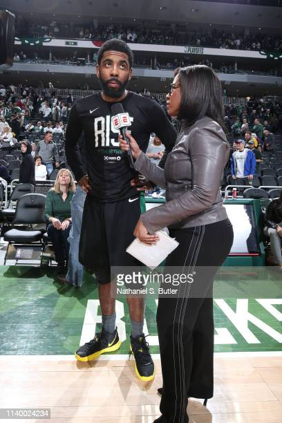 Kyrie Irving of the Boston Celtics talks with the media after the game against the Milwaukee Bucks during Game One of the Eastern Conference...