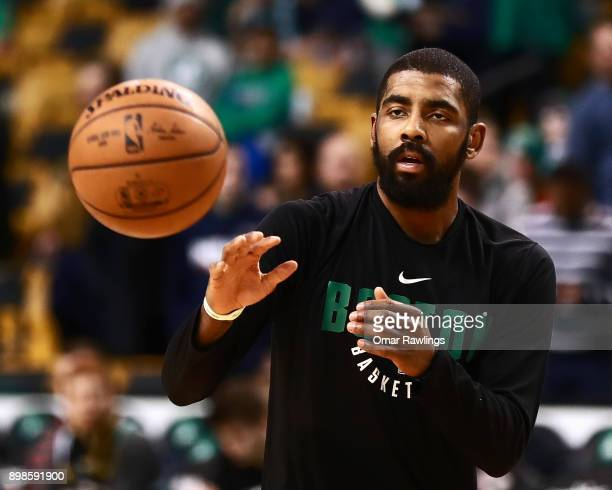 Kyrie Irving of the Boston Celtics warms up before the game against the Washington Wizards at TD Garden on December 25 2017 in Boston Massachusetts...