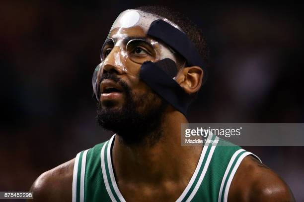 Kyrie Irving of the Boston Celtics wearing a mask due to a facial fracture looks on during the first quarter against the Golden State Warriors at TD...