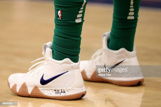 Kyrie Irving of the Boston Celtics wears a pair of his shoes against the New York Knicks during their game at Madison Square Garden on December 21...