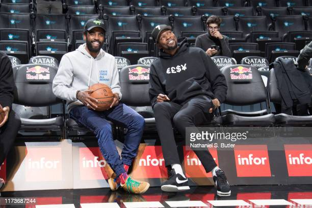 Kyrie Irving of the Brooklyn Nets and Kevin Durant of the Brooklyn Nets shares a laugh before the game on October 4 2019 at Barclays Center in...