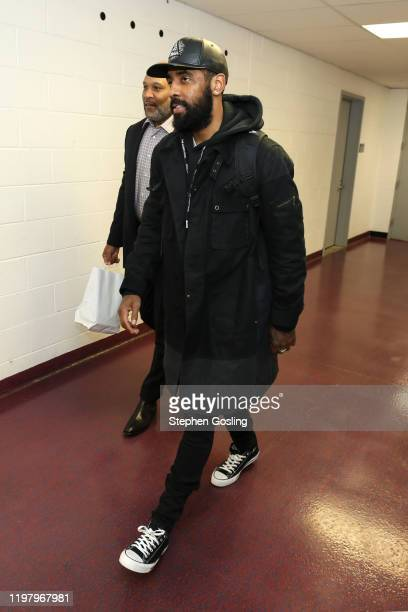 Kyrie Irving of the Brooklyn Nets arrives for the game against the Washington Wizards on February 1 2020 at Capital One Arena in Washington DC NOTE...