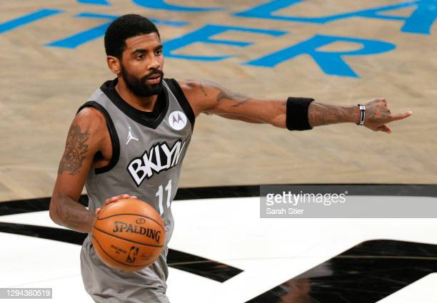 Kyrie Irving of the Brooklyn Nets calls a play during the second half against the Washington Wizards at Barclays Center on January 03, 2021 in the...