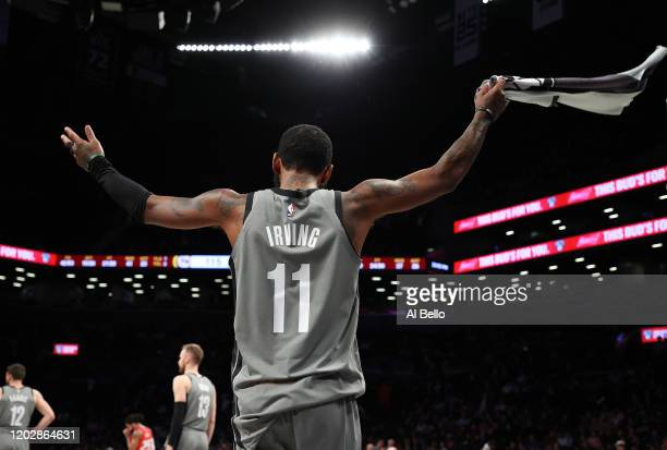 Kyrie Irving of the Brooklyn Nets celebrates a 125-115 win against the Detroit Pistons during their game at Barclays Center on January 29, 2020 in...