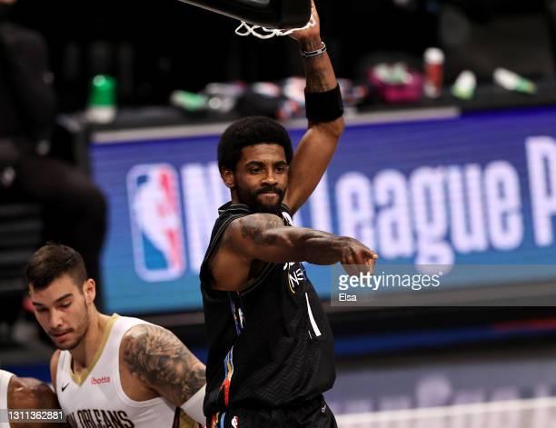 Kyrie Irving of the Brooklyn Nets celebrates his dunk in the first quarter against the New Orleans Pelicans at Barclays Center on April 07, 2021 in...