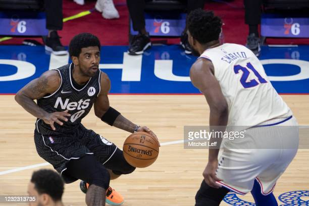 Kyrie Irving of the Brooklyn Nets controls the ball against Joel Embiid of the Philadelphia 76ers in the first quarter at the Wells Fargo Center on...