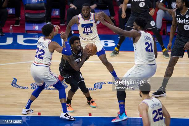 Kyrie Irving of the Brooklyn Nets draws a triple-team from Matisse Thybulle, Shake Milton and Joel Embiid of the Philadelphia 76ers in the first...